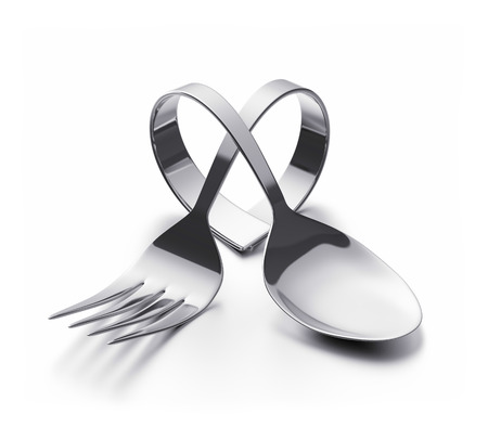 Bent spoon and fork representing a heart Stock Photo - 31489953