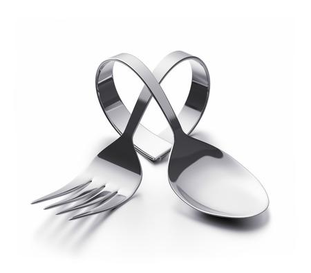 utensilios de cocina: Cuchara y tenedor doblado que representa un corazón Foto de archivo