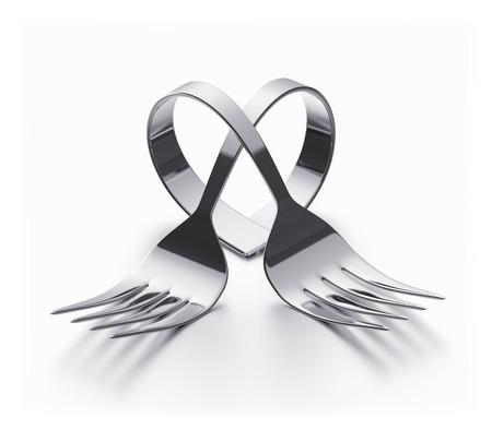 utensilios de cocina: Dos tenedores doblados que representa un corazón