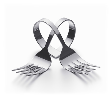 Two forks bent representing a heart