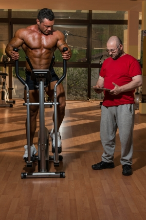 physique: training in gym where partner gives encouragement