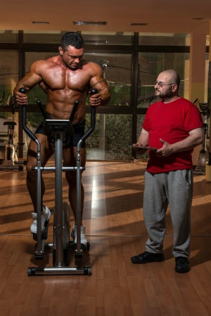 training in gym where partner gives encouragement photo