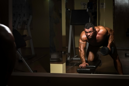 body building: male bodybuilder doing heavy weight exercise for back Stock Photo