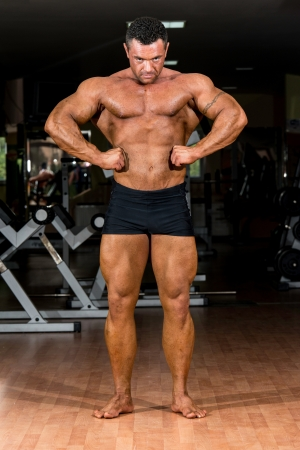muscular body builder showing his front lat spread Stock Photo