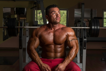 body builder: shirtless bodybuilder resting at the bench Stock Photo