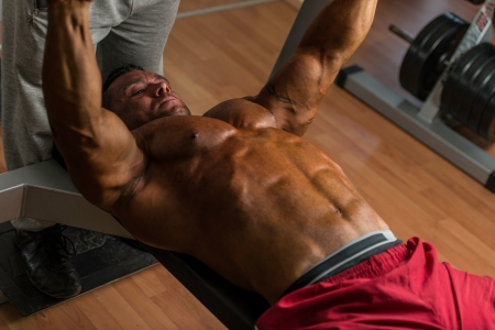 body builder: shirtless body builder doing bench press for chest Stock Photo