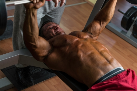 shirtless body builder doing bench press for chest Stock Photo