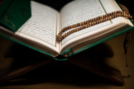 pages of holy koran and rosary at the book Stock Photo - 20251115