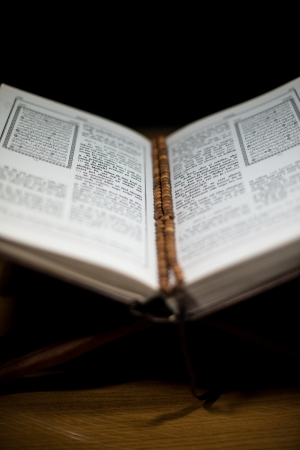 pages of holy koran and rosary at the book photo
