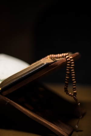kur'an: pages of holy koran and rosary at the book