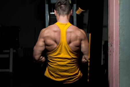 male bodybuilder flexing his back