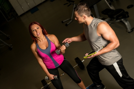 adult  body writing: Woman and Man Exercise in the Gym
