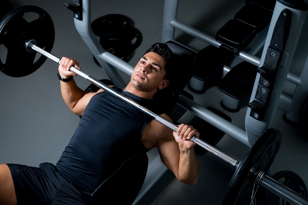 Young Man Working Out in the Gym 스톡 콘텐츠
