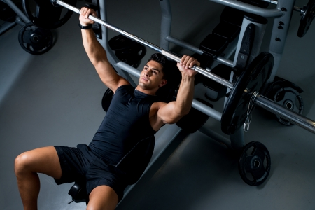 Young Man Working Out in the Gym photo
