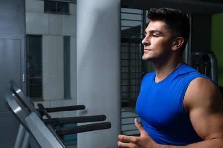 Man jogging in a gym photo