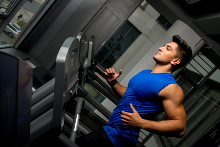 Running on treadmill in gym photo