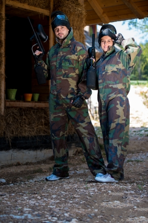 Paintball players posing to the camera photo