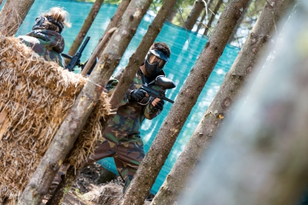 Paintball players running photo