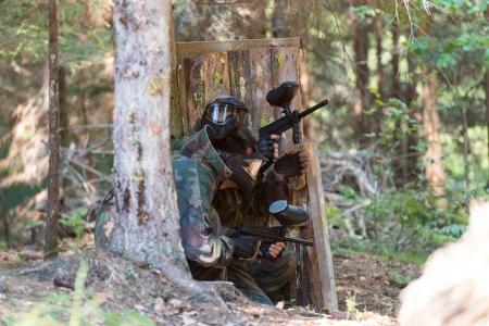 Paintball players Hiding photo
