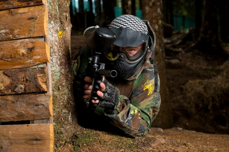 paintball: Paintball Players Hide Behind Tree