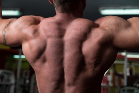 Bodybuilder Doing Exercise For Back photo