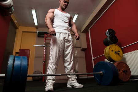 Man preparing to do deadlift photo