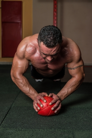 pushups: Push-ups on Medicine Ball Stock Photo
