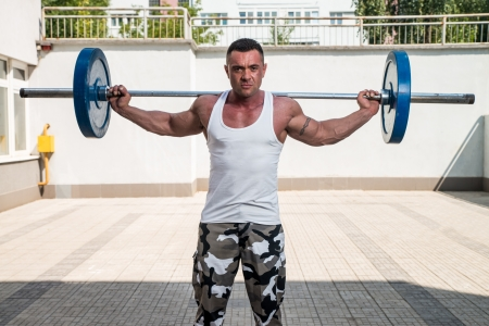 lunges: Man Exercising Lunges With Weights