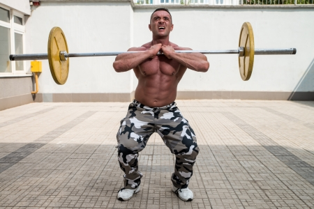 squats: Man Doing Front Squats