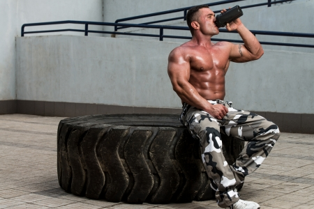 body building: Bodybuilder Drinking Stock Photo