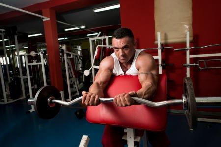 Bodybuilder Doing Heavy Barbell Exercise photo