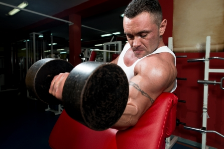 Powerful Muscular Man Lifting Weights photo