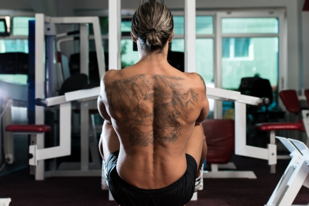 Man Working Out A Exercise For Back photo