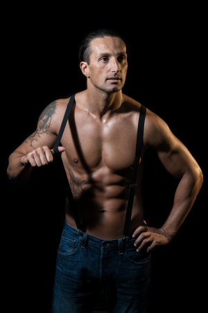 flaunt: Shirtless Man with Suspenders Stock Photo