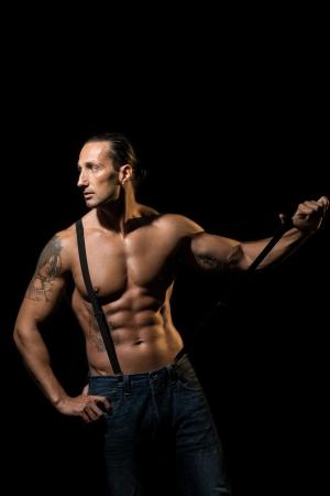 Sexy macho man with black suspenders Stock Photo - 22602497