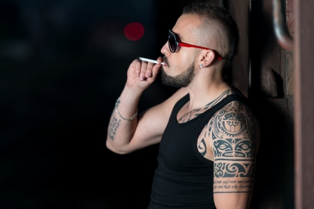 cigare: Dangerous Man With Cigare Isolated On Black Stock Photo