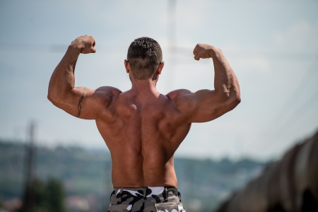 BodyBuilder Posing Double Biceps photo