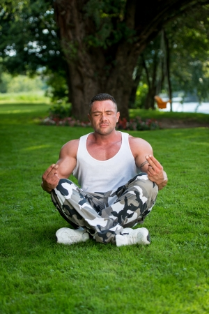 Bodybuilder Meditating photo