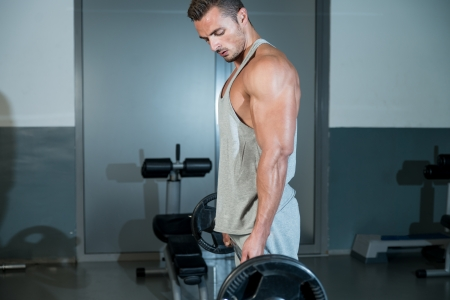 Man Performing Heavy Deadlift In A Gym
