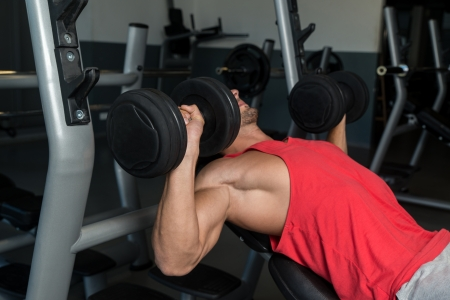 Man Pressing Dumbbells photo