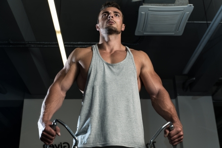 Body Builder Workout On Cable Machine