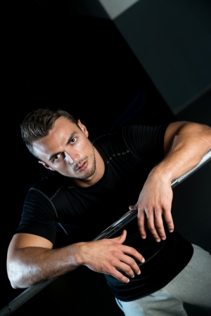 Young Muscular Caucasian Man Resting At The Gym Stock Photo