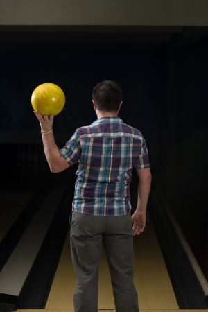 poised: Bowler Poised With His Ball