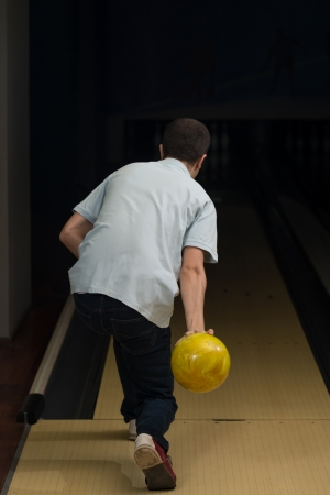 attempts: Bowler Attempts To Take Out Remaining Pins Stock Photo