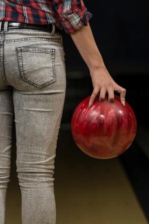 Close-Up Of A Butt Next To A Bowling Ball Banco de Imagens