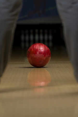 one lane: Bowler Attempts To Take Out Remaining Pins Stock Photo