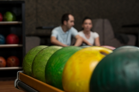 Beautiful Cheerful Couple Talking At The Bowling Alley photo