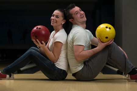 Man Teaching Woman Bowling photo