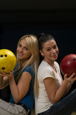 Cheerful Young Couple Holding Bowling Ball photo
