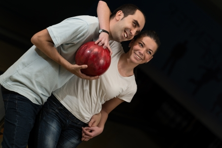 Couple Embracing At The Bowling Alley photo